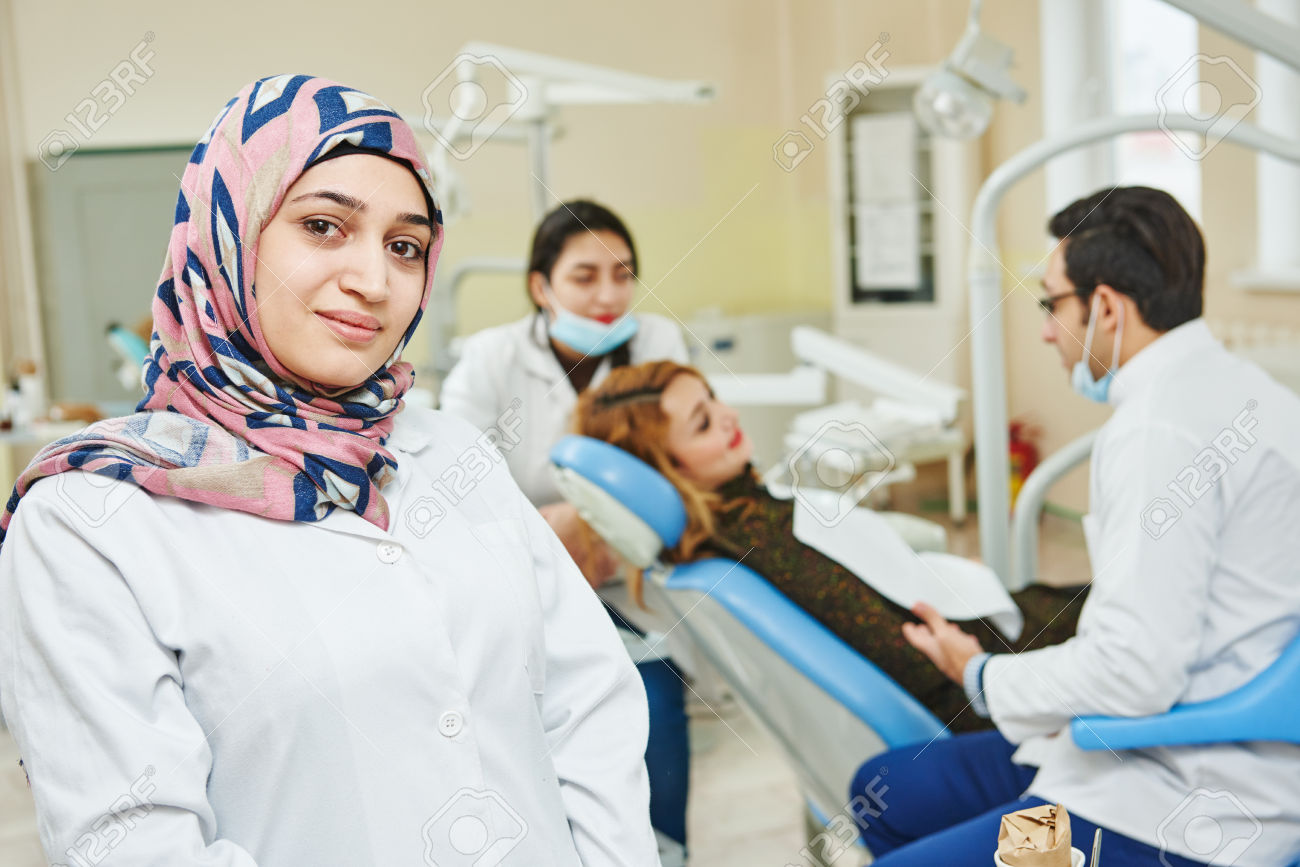 38347398-A-portrait-of-a-iranian-muslim-female-dental-assistant-or-doctor-smiling-the-dentist-working-in-the--Stock-Photo